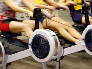 Girls  exercising in the gym on rowing machines